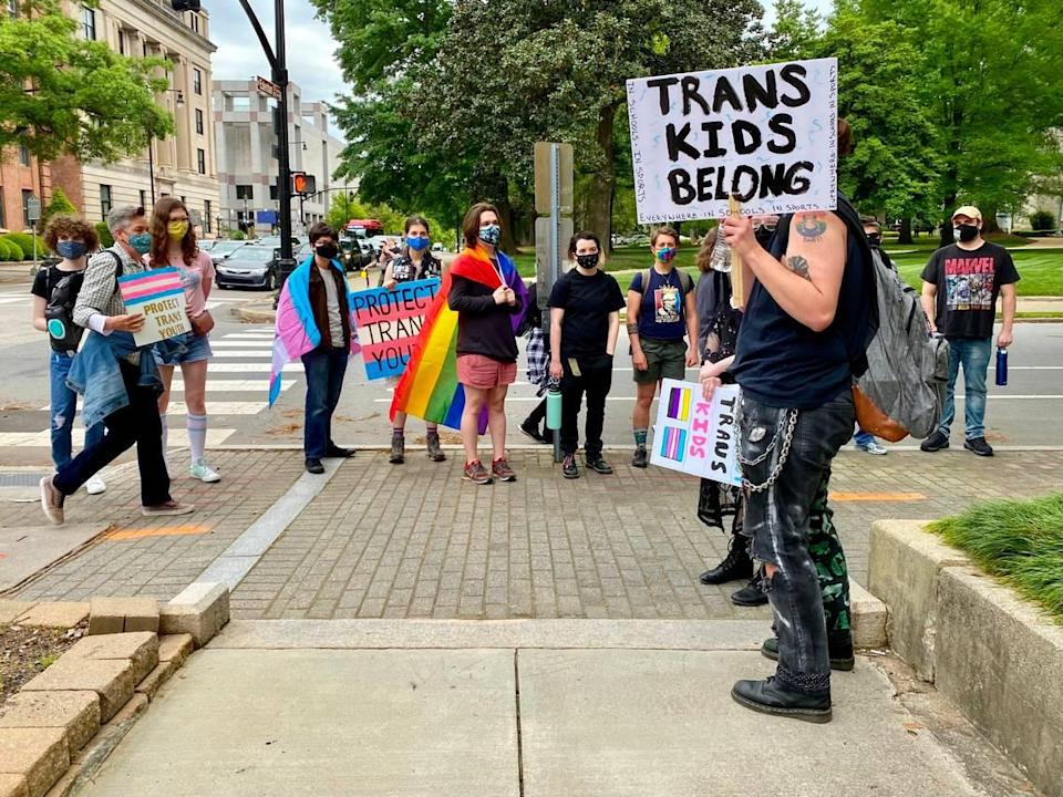 Protestors stop at a downtown Raleigh street corner on Saturday during a demonstration against Senate Bill 514, which would bar doctors from providing gender-affirming treatment to transgender people younger than 21.