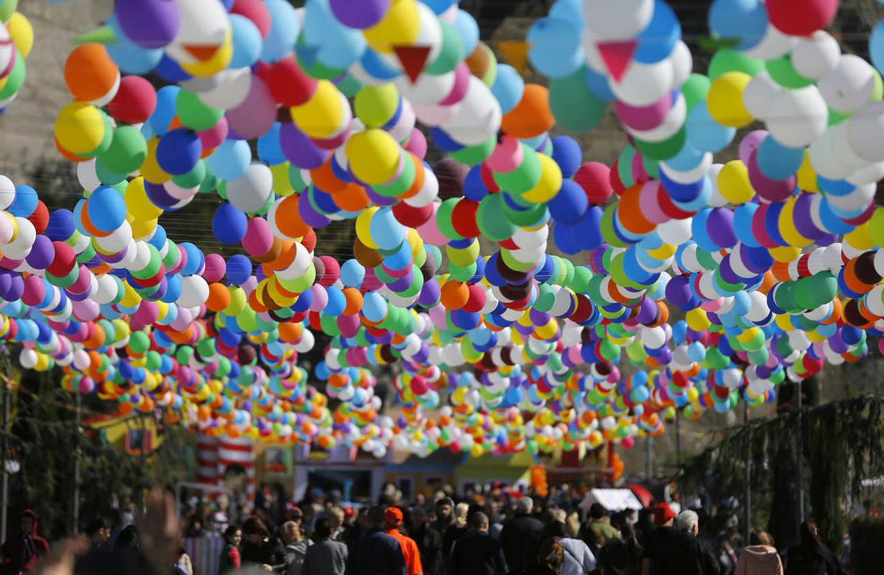 <p>Georgian people walk under balloons as they attend the 'Tbilisoba' celebrations in Tbilisi, Georgia, Oct. 15, 2016. The annual festival is dedicated to the Georgian capital of Tbilisi. (Photo: ZURAB KURTSIKIDZE/EPA) </p>