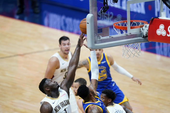 New Orleans Pelicans forward Zion Williamson (1) stops Golden State Warriors forward Kent Bazemore from reaching the basket in the first half of an NBA basketball game in New Orleans, Monday, May 3, 2021. (AP Photo/Gerald Herbert)