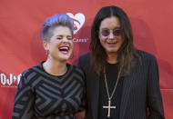 Musician Ozzy Osbourne (R) and his daughter Kelly Osbourne pose at the 10th Annual MusiCares MAP Fund Benefit concert at Club Nokia in Los Angeles, California May 12, 2014. REUTERS/Mario Anzuoni (UNITED STATES - Tags: ENTERTAINMENT)