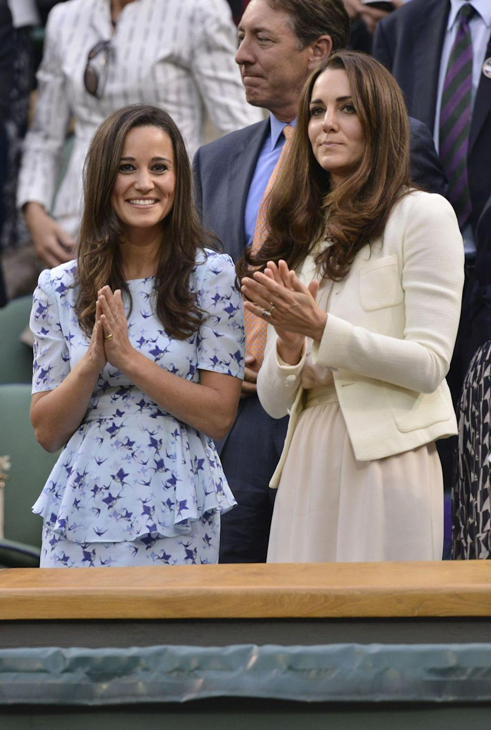 <p>We know we couldn't we leave out the queen of style Kate Middleton and her equally chic sis. <i>[Photo: REX]</i></p>