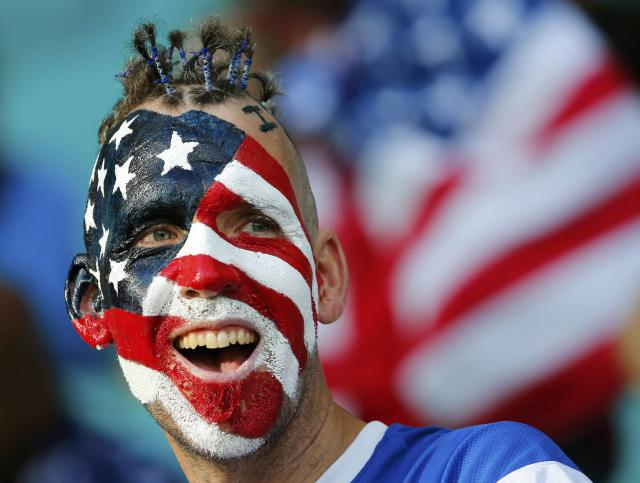 A U.S. fan cheers before the 2014 World Cup round of 16 game between U.S. and Belgium at the Fonte Nova arena in Salvador July 1, 2014. REUTERS/Yves Herman (BRAZIL - Tags: SOCCER SPORT WORLD CUP TPX IMAGES OF THE DAY)
