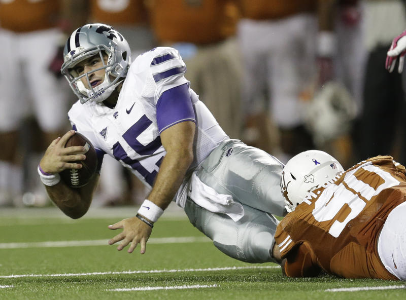 Kansas State's Jake Waters (15) is taken down by Texas' Malcom Brown (90) during the second half of an NCAA college football game on Saturday, Sept. 21, 2013, in Austin, Texas. (AP Photo/Eric Gay)