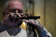 Stylist and salon owner Adam Reed is part of a collective in Britain urging more hairdressers to recyle unwanted hair