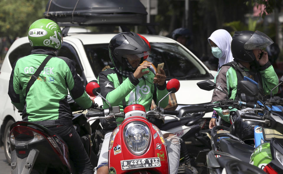 Go-Jek drivers wait for customers in Jakarta, Indonesia. (AP Photo/Achmad Ibrahim)