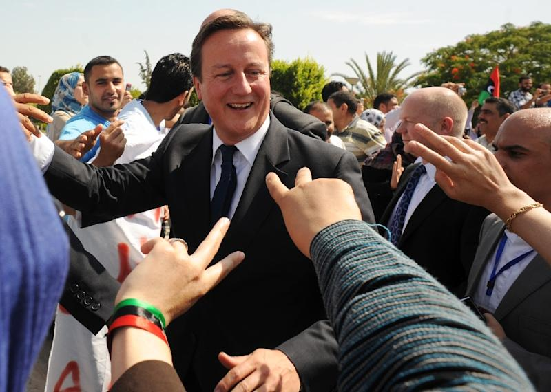 British Prime Minister David Cameron received a hero's welcome during a visit to the Libyan capital Tripoli after the overthrow of Moamer Kadhafi in 2011 (AFP Photo/Stefan Rousseau)