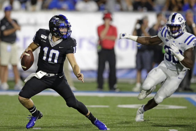 Middle Tennessee quarterback Asher O'Hara (10) scrambles from Duke linebacker Brandon Hill (32) in the first half of an NCAA college football game Saturday, Sept. 14, 2019, in Murfreesboro, Tenn. (AP Photo/Mark Humphrey)
