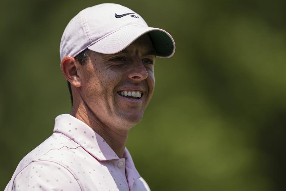 Rory McIlroy smiles after his putt on the third hole during the fourth round of the Wells Fargo Championship golf tournament at Quail Hollow on Sunday, May 9, 2021, in Charlotte, N.C. (AP Photo/Jacob Kupferman)