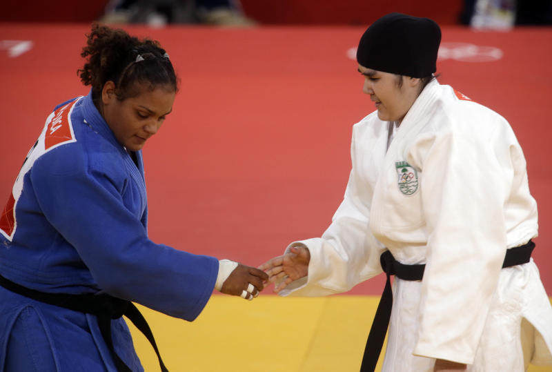 Saudi Arabia's Wojdan Shahrkani and Puerto Rico's Melissa Mojica compete during the women's 78-kg judo competition at the 2012 Summer Olympics, Friday, Aug. 3, 2012, in London. (AP Photo/Mike Groll)