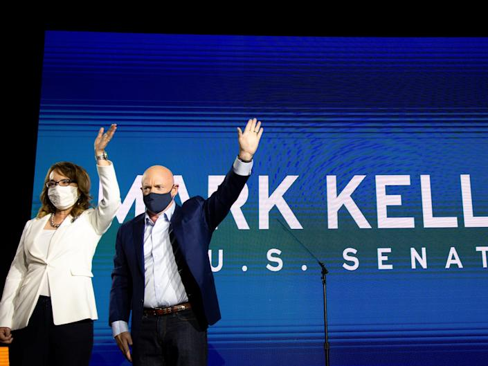 <p>Mark Kelly and Gabrielle Giffords on the night of his victory in Arizona</p> (Getty Images)