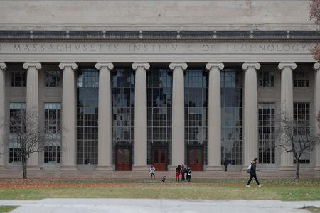People stand in front of Building 10 behind Killian Court at the Massachusetts Institute of Technology (MIT) in Cambridge, Massachusetts, U.S., November 21, 2018. REUTERS/Brian Snyder
