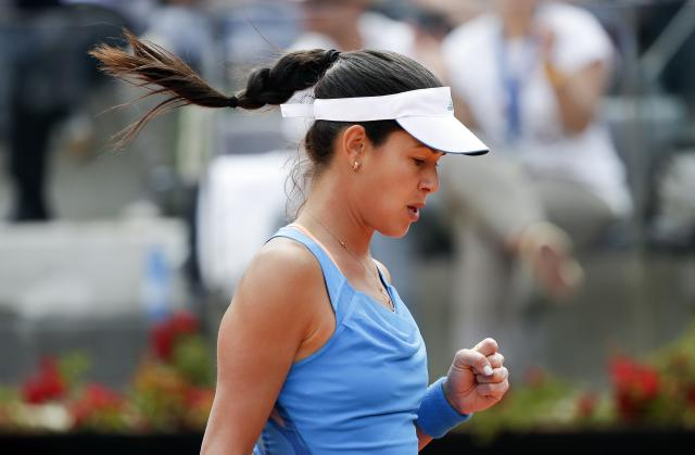 Ana Ivanovic of Serbia reacts during her women's singles match against Maria Sharapova of Russia at the Rome Masters tennis tournament May 15, 2014. REUTERS/Max Rossi (ITALY - Tags: SPORT TENNIS)