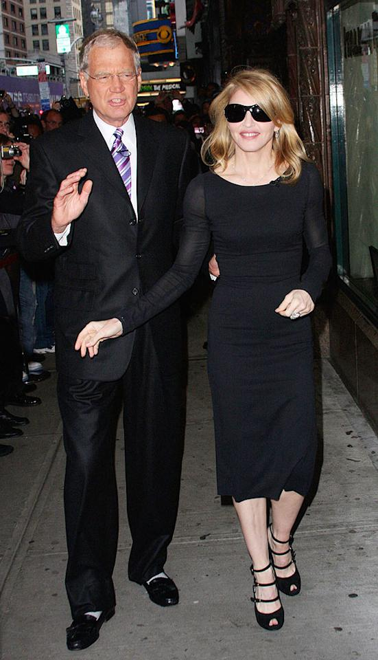 "David Letterman and Madonna walk to a pizzeria during the taping of the ""Late Show With David Letterman."" Marcel Thomas/<a href=""http://www.filmmagic.com/"" target=""new"">FilmMagic.com</a> - September 30, 2009"