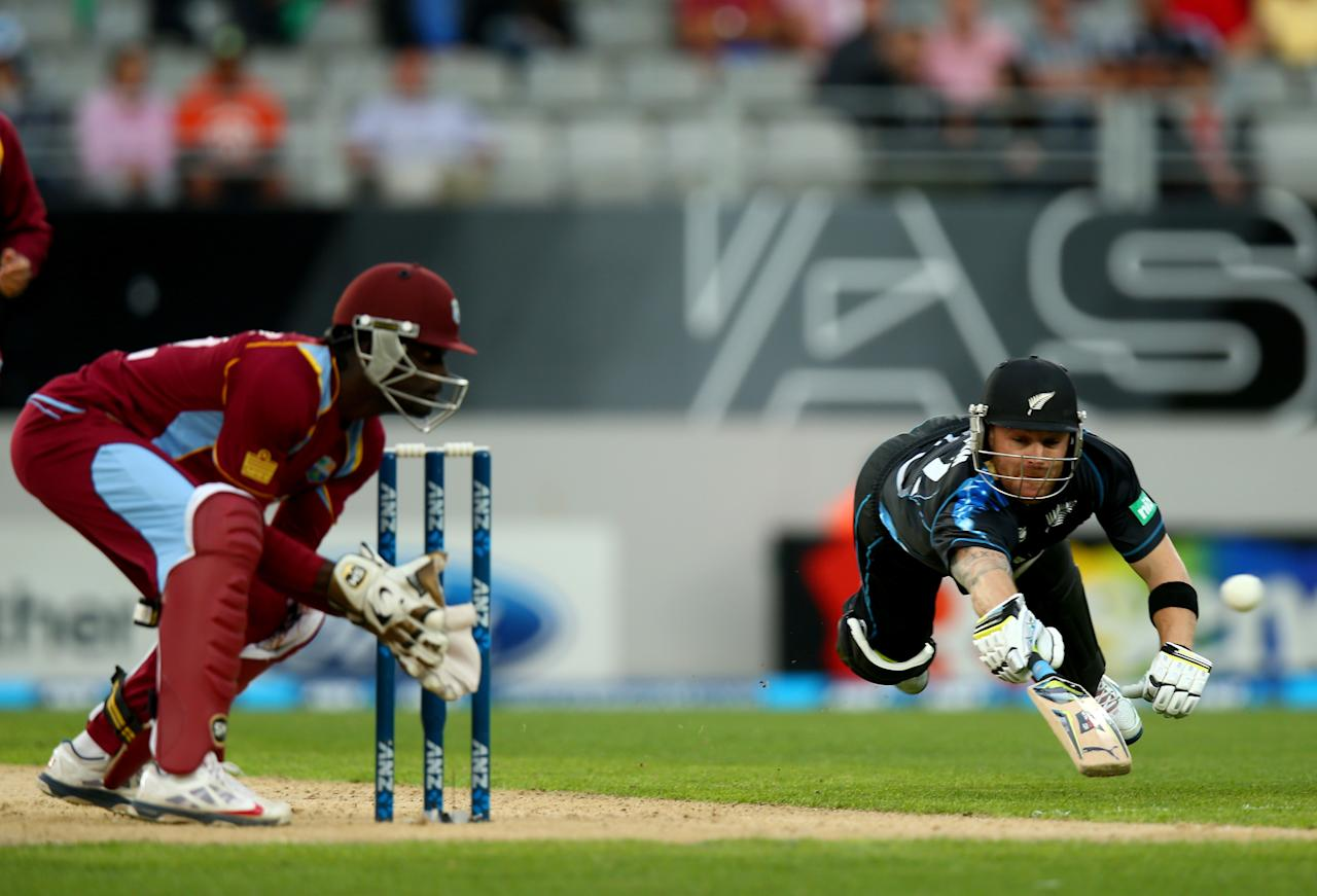 AUCKLAND, NEW ZEALAND - JANUARY 11: Brendon McCullum of New Zealand dives to make his crease as Andre Fletcher of the West Indies collects the ball during the first T20 between New Zealand and the West Indies at Eden Park on January 11, 2014 in Auckland, New Zealand.  (Photo by Phil Walter/Getty Images)