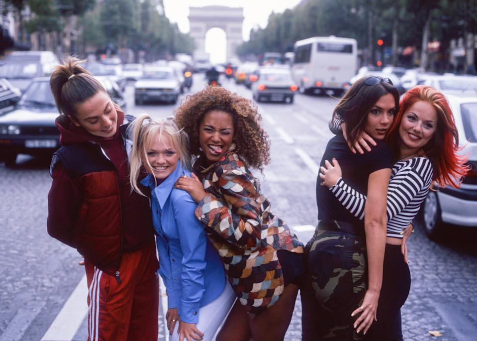 Spice Girls, portrait, in the street in Paris, France, 1996. L-R Mel C, Emma Bunton, Mel B, Victoria Adams, Geri Halliwell. (Photo by Tim Roney/Getty Images)
