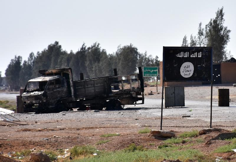 The Islamic State group's trademark black flag is seen near their former bastion of Raqa after pro-government forces entered the area in summer 2017