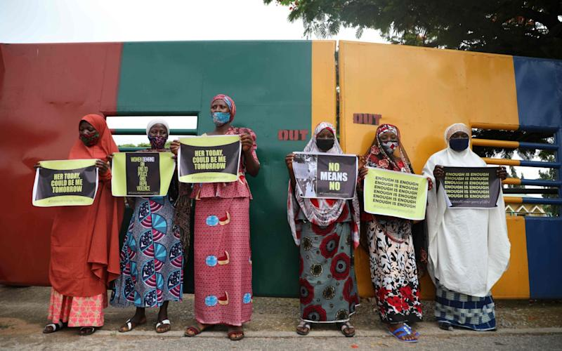 Protesters wearing face mask, hold placards and banners outside the Nigerian Police Headquarters in Abuja, the capital, during a demonstration to raise awareness about sexual violence on June 5, 2020.  - KOLA SULAIMON /AFP