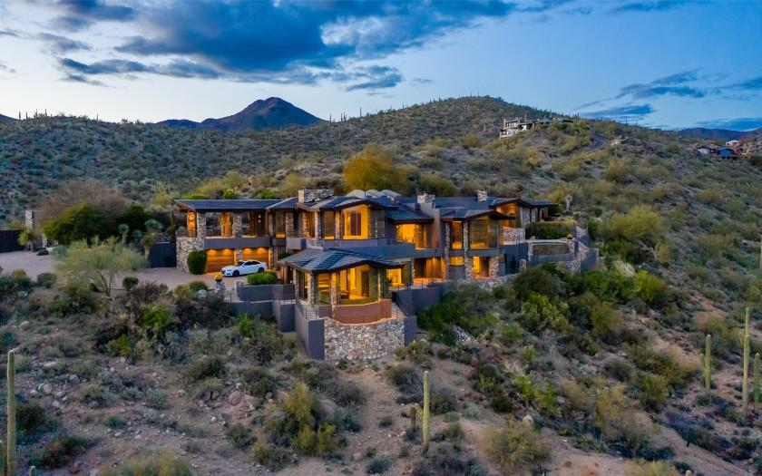 The 12-acre estate centers on a 9,000-square-foot home made of stone, copper and glass.
