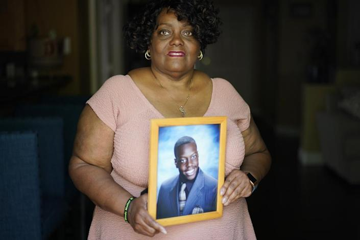 Diane Wilson holds a photo of her son Tyrell Wilson, Wednesday, May 5, 2021, in North Las Vegas, who was was shot and killed by Police Officer Andrew Hall in Danville, Calif., on March 11. (AP Photo/John Locher)