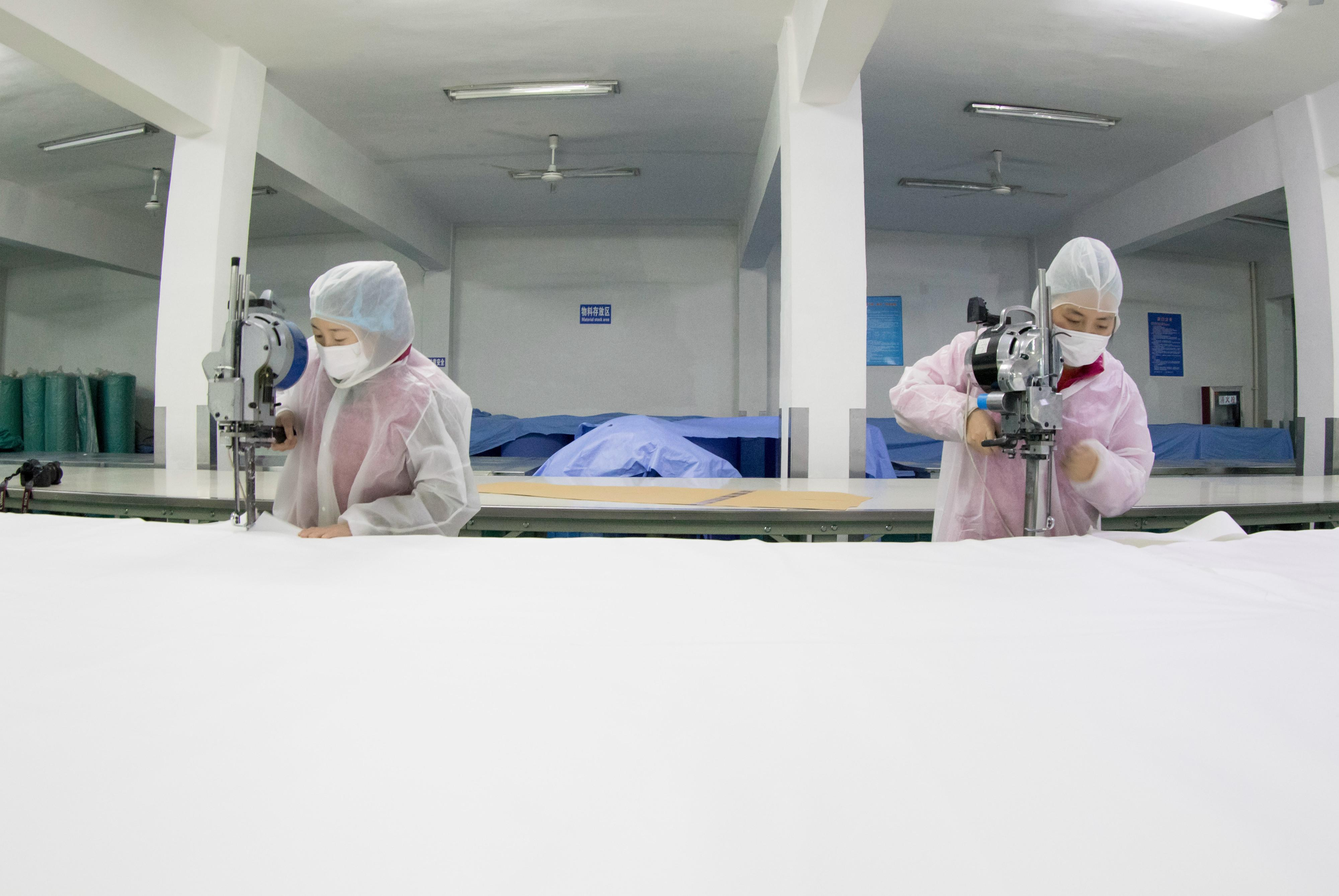 Chinese workers manufacture protective clothing at the plant of a medical material company in Libao Town, Hai'an City, east China's Jiangsu Province on February 6th, 2020. (Photo by Zhai Huiyong / Costfoto/Sipa USA)