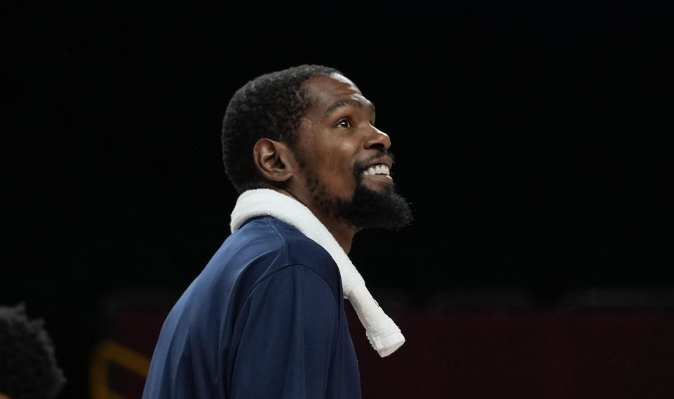 United States' Kevin Durant (7) smiles after their win in the men's basketball preliminary round game against Iran at the 2020 Summer Olympics, Wednesday, July 28, 2021, in Saitama, Japan. (AP Photo/Eric Gay)