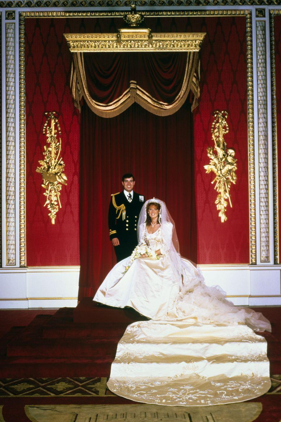"<p>British courtier Lindka Cierach designed Sarah Ferguson's ivory duchesse satin and delicately beaded dress. In lovingly detailed fashion, the bottom of the dress's 17-foot-train *literally* featured a large beaded ""A"" for Andrew. </p>"