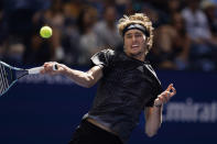 Alexander Zverev, of Germany, returns a shot against Jannik Sinner, of Italy, during the fourth round of the US Open tennis championships, Monday, Sept. 6, 2021, in New York. (AP Photo/Seth Wenig)