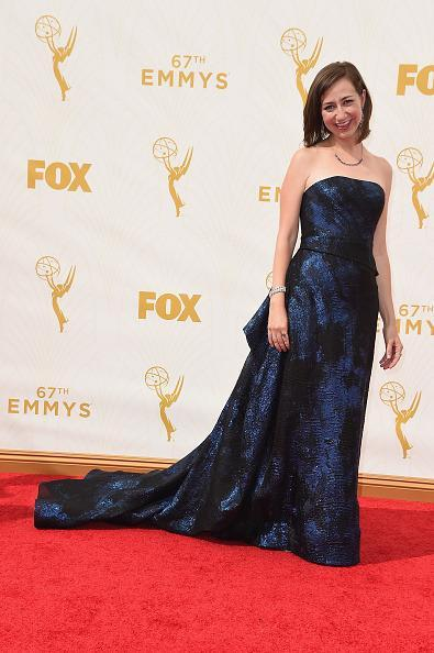 """<p>Is that you Kristen Schaal?! The """"Last Man on Earth"""" actress wore her hair in a sleek angular bob and paired it with a strapless navy blue gown with major volume. Keep it up, babe!</p>"""