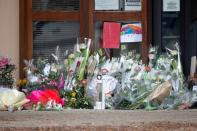 Flowers at the Bois d'Aulne college are seen after the attack in the Paris suburb of Conflans St Honorine