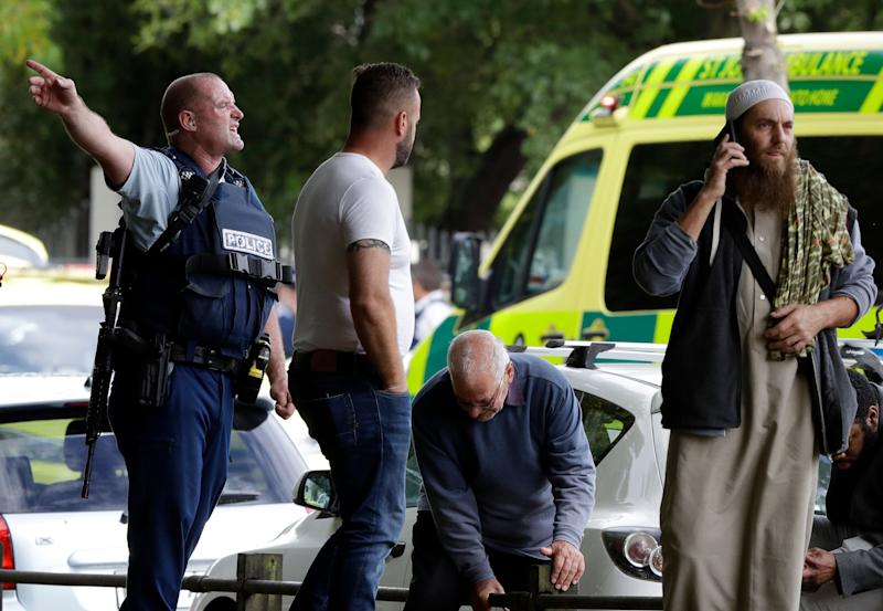 Police attempt to clear people from outside a mosque in central Christchurch after a mass shooting in New Zealand on March 15, 2019.