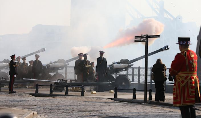 Members of the Honourable Artillery Company (HAC) fire a 62-round gun salute from the wharf at the Tower of London, to mark the 68th anniversary of the accession of Queen Elizabeth II to the throne in 1952. (Photo by Luciana Guerra/PA Images via Getty Images)