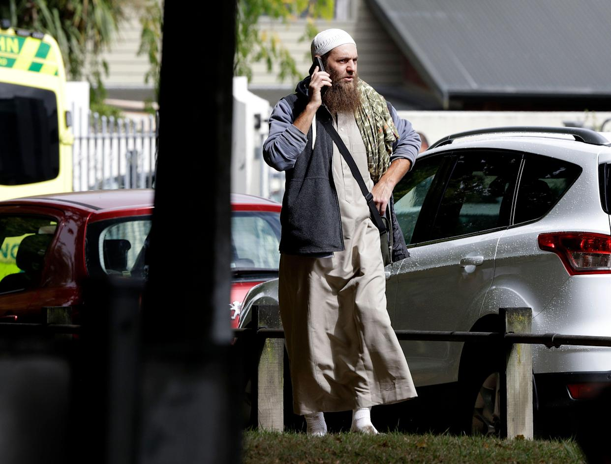 A man talks on his mobile phone across the road from a mosque in central Christchurch, New Zealand, Friday, March 15, 2019. (Photo: Mark Baker/AP)