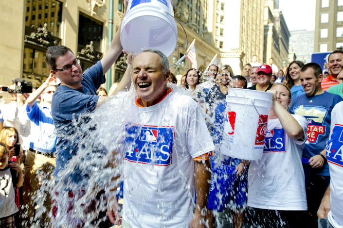 Major League Baseball Commissioner-elect Rob Manfred participates in the ALS Ice-Bucket Challenge outside the organization's headquarters in New York, Aug. 20, 2014. (Vanessa A. Alvarez/AP)