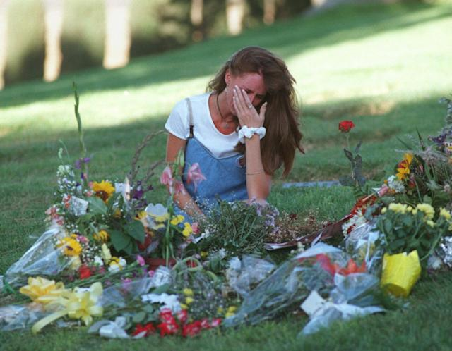 "<p>Kimberly Goldman, sister of murder victim Ronald Goldman, sits and weeps at Ronald's gravesite in Agoura, Calif., Tuesday, Oct. 3, 1995. Kimberly came to the gravesite after the jury in the O.J. Simpson murder trial came back Tuesday morning with a ""not guilty"" verdict. (Photo: Olga Shalygin/AP) </p>"