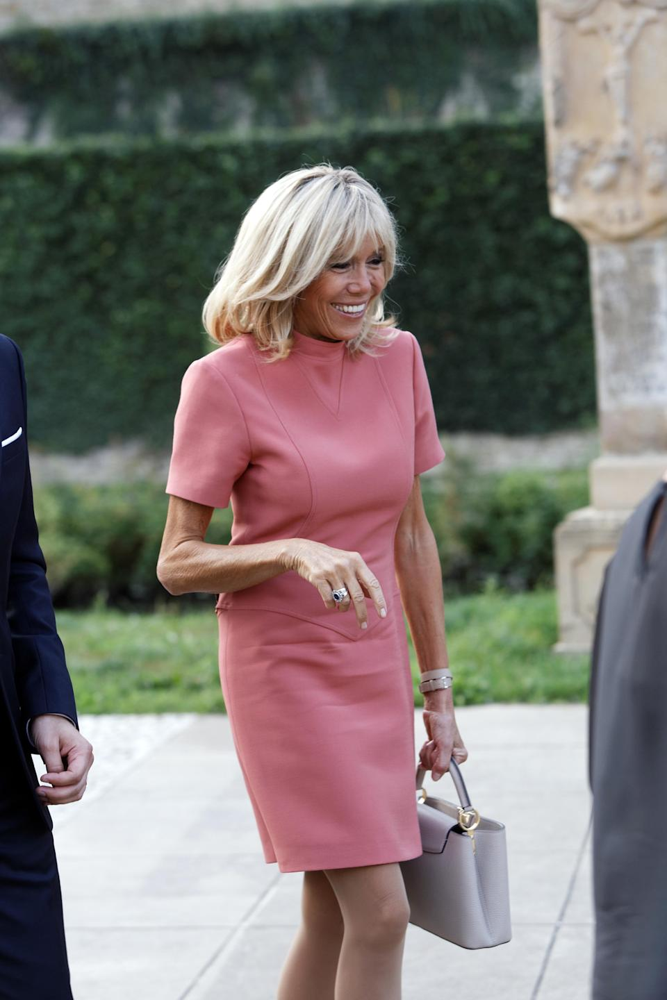 French first lady Brigitte Macron wore a bright-pink dress to Luxembourg last August. (Photo: Getty Images)