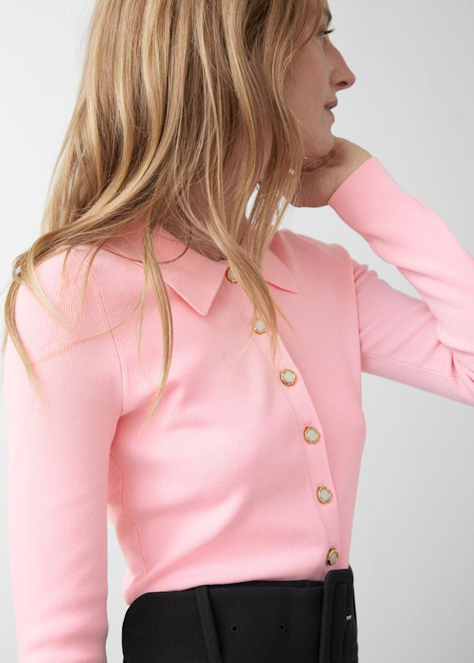 """<p>I don't usually go for pink during this time of year, but as we lean into <a href=""""https://www.harpersbazaar.com/uk/fashion/a31255947/end-of-fashion-seasons/"""" target=""""_blank"""" class=""""ga-track"""" data-ga-category=""""internal click"""" data-ga-label=""""https://www.harpersbazaar.com/uk/fashion/a31255947/end-of-fashion-seasons/"""" data-ga-action=""""body text link"""">seasonless dressing</a> these days, this <product href=""""https://www.stories.com/en_usd/clothing/knitwear/sweaters/product.polo-collar-button-up-sweater-pink.0901210002.html"""" target=""""_blank"""" class=""""ga-track"""" data-ga-category=""""internal click"""" data-ga-label=""""https://www.stories.com/en_usd/clothing/knitwear/sweaters/product.polo-collar-button-up-sweater-pink.0901210002.html"""" data-ga-action=""""body text link"""">&amp; Other Stories Polo Collar Button-Up Sweater</product> ($69) will be my new go-to. I can wear it from now through Spring 2021.</p>"""