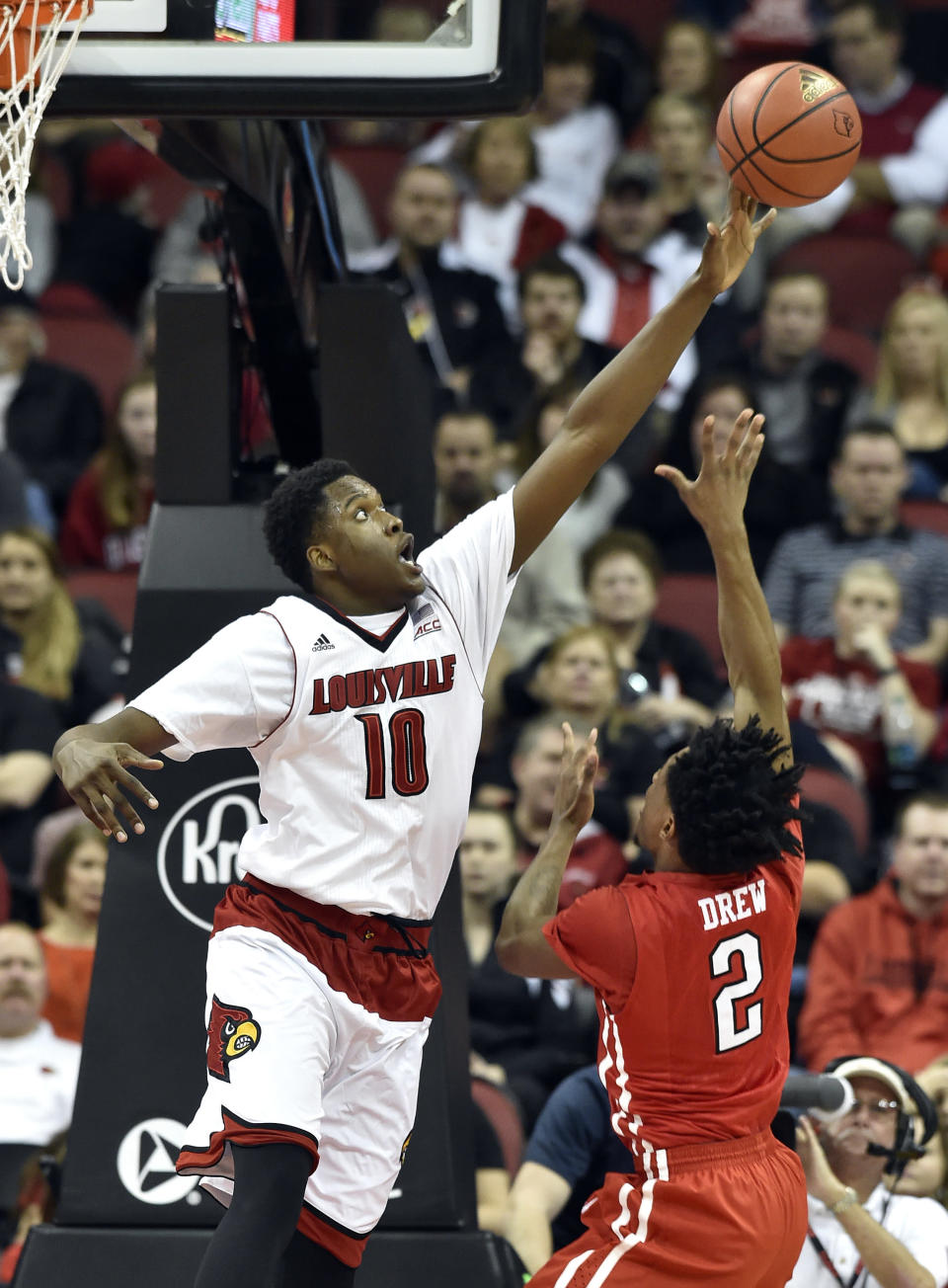 Louisville's Jaylen Johnson, left. blocks the shot of Cal State Northridge's Landon Drew during the first half of an NCAA college basketball game Tuesday Dec. 23, 2014, in Louisville, Ky. (AP Photo/Timothy D. Easley)