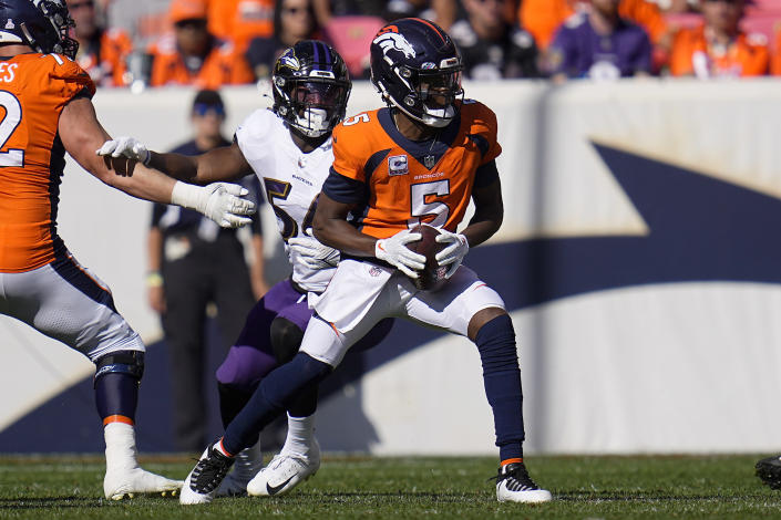 Denver Broncos quarterback Teddy Bridgewater (5) is hurried by Baltimore Ravens outside linebacker Tyus Bowser (54) during the first half of an NFL football game, Sunday, Oct. 3, 2021, in Denver. (AP Photo/Jack Dempsey)