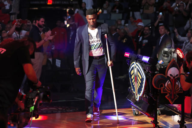 """Though he's feeling better each day, <a class=""""link rapid-noclick-resp"""" href=""""/nba/players/6163/"""" data-ylk=""""slk:Zion Williamson"""">Zion Williamson</a> isn't rushing his recovery after knee surgery. (AP/Gerald Herbert)"""