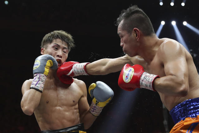 Philippines' Nonito Donaire, right, sends a right to Japan's Naoya Inoue in the fifth round of their World Boxing Super Series bantamweight final match in Saitama, Japan, Thursday, Nov. 7, 2019. Inoue beat Donaire with a unanimous decision to win the championship. (AP Photo/Toru Takahashi)