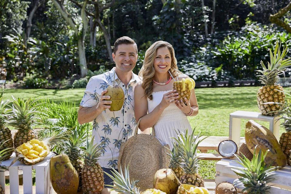 Kavan Smith and Pascale Hutton Holding Pineapple drinks