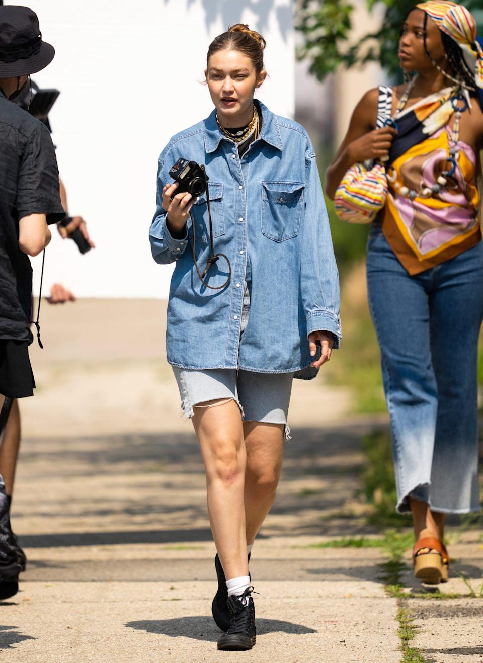 <p>Gigi Hadid mans the camera during a photoshoot with friends Alana O'Herlihy and Gabriella Karefe-Johnson in Brooklyn, New York on July 27. </p>