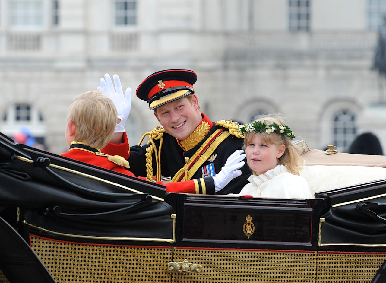 LONDON, ENGLAND - APRIL 29:  In this handout image provided by Crown Copyright,  Prince Harry waves to the crowd as they make the journey by carriage procession to Buckingham Palace following their marriage at Westminster Abbey on April 29, 2011 in London, England. The marriage of the second in line to the British throne was led by the Archbishop of Canterbury and was attended by 1900 guests, including foreign Royal family members and heads of state. Thousands of well-wishers from around the world have also flocked to London to witness the spectacle and pageantry of the Royal Wedding.  (Sergeant Dan Harmer RLC/Mandatory Credit MOD/Crown Copyright via Getty Images)