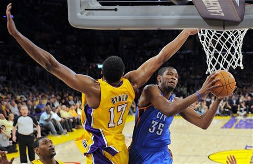 Oklahoma City Thunder forward Kevin Durant, right, goes up for a shot as Los Angeles Lakers center Andrew Bynum defends during the first half in Game 4 of an NBA basketball playoffs Western Conference semifinal, Saturday, May 19, 2012, in Los Angeles. (AP Photo/Mark J. Terrill)
