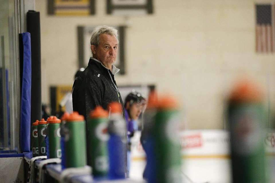Los Angeles Kings head coach Darryl Sutter watches during NHL hockey training camp Friday, Sept. 19, 2014, in El Segundo, Calif. The Kings went through their first workouts of training camp Friday as they prepare for their run at a third NHL title in four seasons. (AP Photo/Jae C. Hong)