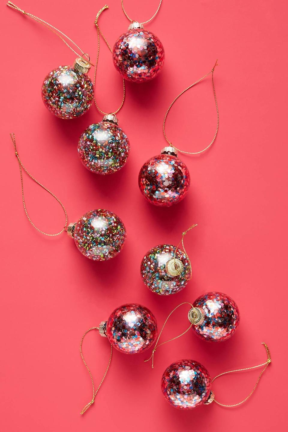 """<p>The <a href=""""https://www.popsugar.com/buy/Confetti-Ornaments-Set-Nine-490566?p_name=Confetti%20Ornaments%2C%20Set%20of%20Nine&retailer=anthropologie.com&pid=490566&price=20&evar1=casa%3Aus&evar9=46615300&evar98=https%3A%2F%2Fwww.popsugar.com%2Fhome%2Fphoto-gallery%2F46615300%2Fimage%2F46615437%2FConfetti-Ornaments-Set-Nine&list1=shopping%2Canthropologie%2Choliday%2Cchristmas%2Cchristmas%20decorations%2Choliday%20decor%2Chome%20shopping&prop13=mobile&pdata=1"""" rel=""""nofollow noopener"""" class=""""link rapid-noclick-resp"""" target=""""_blank"""" data-ylk=""""slk:Confetti Ornaments, Set of Nine"""">Confetti Ornaments, Set of Nine</a> ($20) are so fun and festive, you can't help but be in the holiday spirit. </p>"""