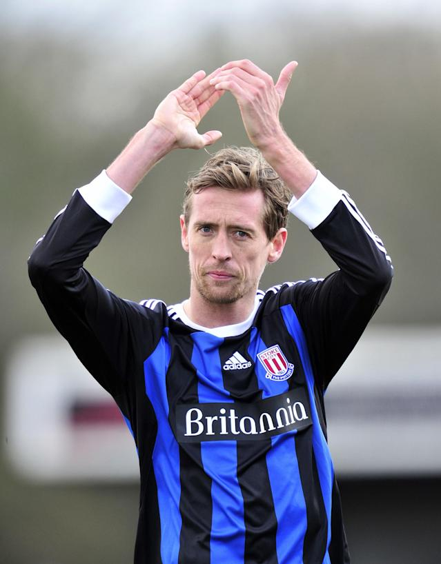 "Stoke City's striker Peter Crouch thanks the fans after winning their FA Cup fifth round football match 2-0 against Crawley Town at Broadfield Stadium in Crawley, England on February 19, 2012. AFP PHOTO/GLYN KIRK RESTRICTED TO EDITORIAL USE. No use with unauthorized audio, video, data, fixture lists, club/league logos or ""live"" services. Online in-match use limited to 45 images, no video emulation. No use in betting, games or single club/league/player publications. (Photo credit should read GLYN KIRK/AFP/Getty Images)"