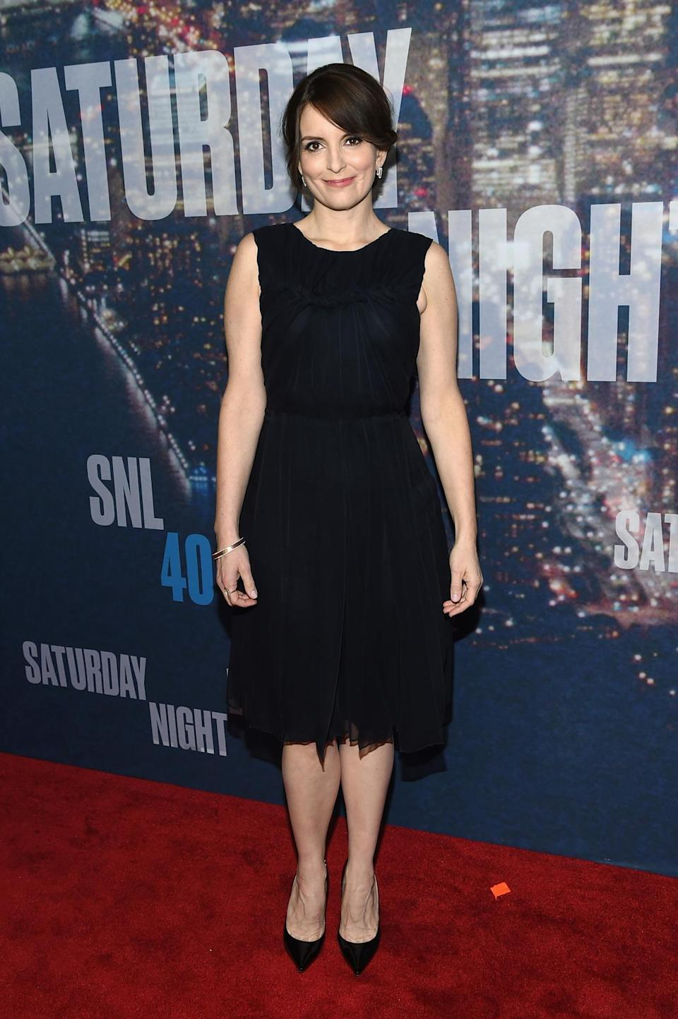 Tina Fey keeps it simple in a little black dress before making multiple costume changes such as into her iconic Sarah Palin getup.