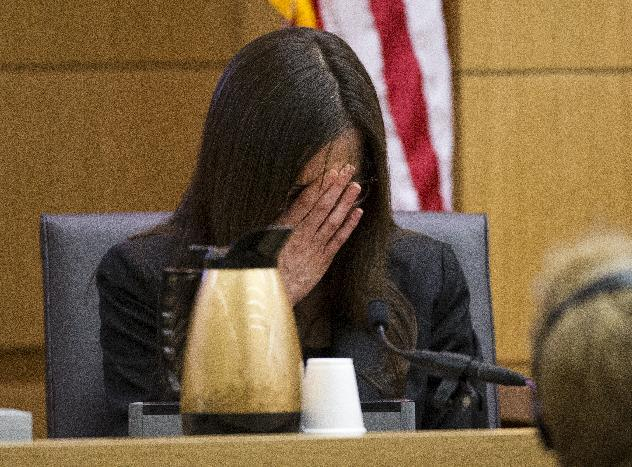 Jodi Arias breaks down after being asked by prosecutor Juan Martinez if she was crying when she stabbed Travis Alexander and when she slit his throat, during cross examination at Arias' murder trial on Thursday, Feb. 28, 2013 in Phoenix. Arias, 32, is charged in the June 2008 killing her lover, Alexander, in his suburban Phoenix home. She says she was forced to fight for her life after Alexander attacked her, but police say she planned the killing in a jealous rage. Arias initially told authorities she had nothing to do with Alexander's death, then later blamed it on masked intruders before eventually settling on self-defense. (AP Photo/The Arizona Republic, Tom Tingle, Pool)