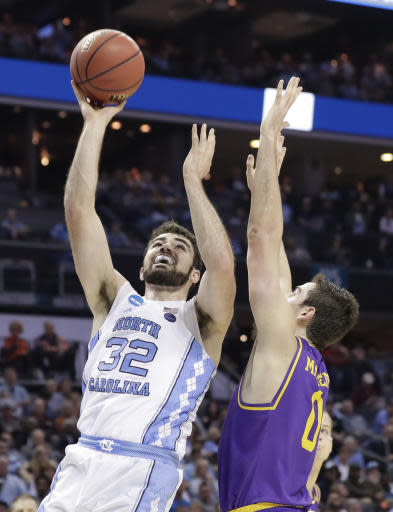 North Carolina's Luke Maye (32) shoots against Lipscomb's Rob Marberry (0) during the first half of a first-round game in the NCAA men's college basketball tournament in Charlotte, N.C., Friday, March 16, 2018. (AP Photo/Gerry Broome)